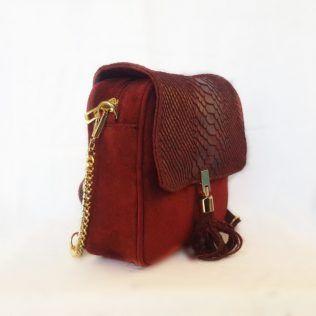 Bolso bandolera combina textil y piel